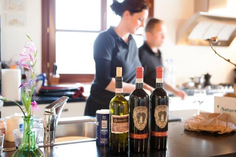 Making dinner in kitchen Villa Casa al Pino, Riparbella in Tuscany