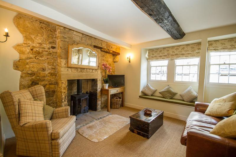 ...'a roaring fire and all the charm and coziness you'd expect from a traditional Cotswold cottage'.