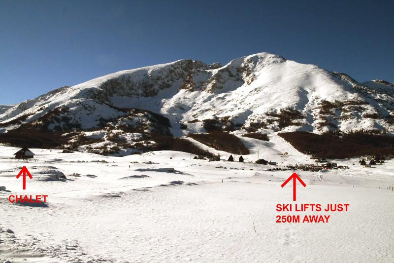 View of dramatic Savin Kuk mountain - chalet far left and ski lifts to right