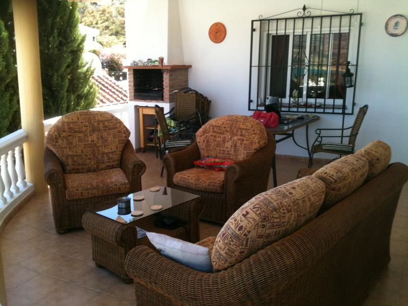 Terrace undercover with comfortable furniture and BBQ