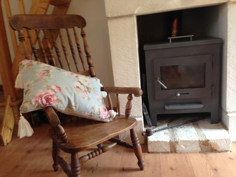 Relax  by the Cosy fireplace in cooler months
