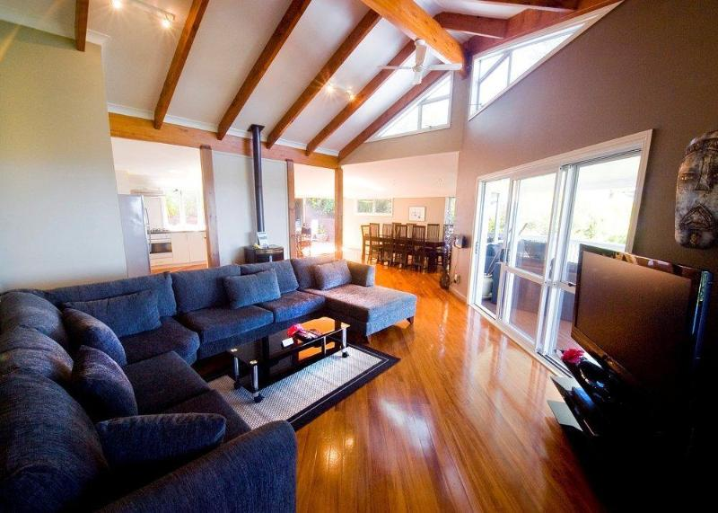 Massive Living room with Vaulted Ceilings, Hardwood Floors, Romantic Fireplace