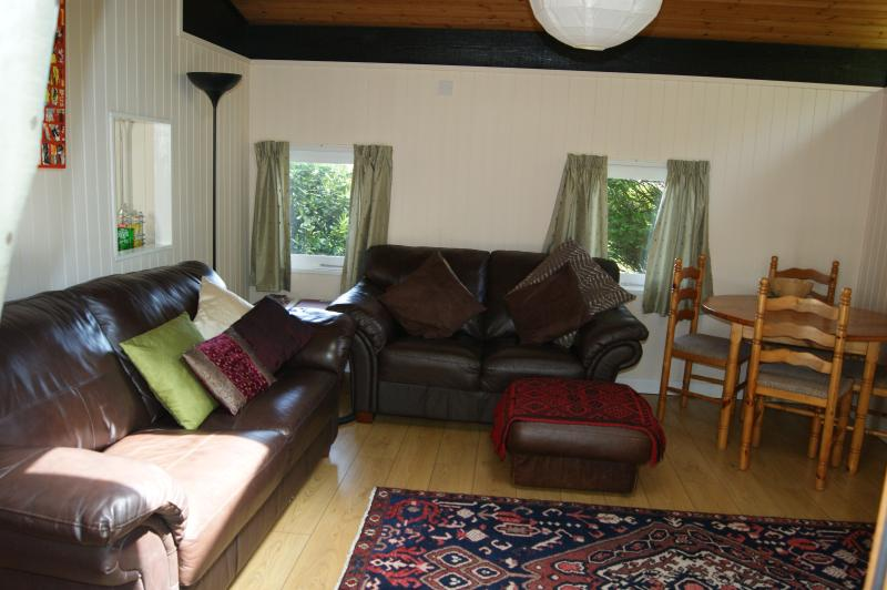 spacious and comfortable front room with flat screen telly and digital radio