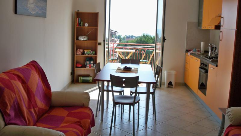 Kitchen and dining area opens onto balcony.