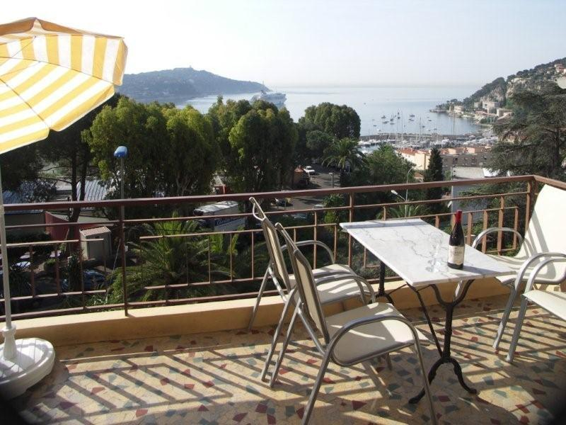 View from balcony across bay to Cap Ferrat. We also have an electrically operated awning.