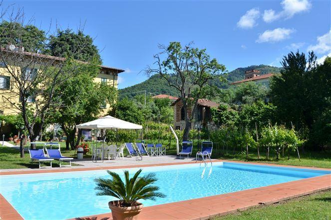 The swimming pool in the big beautifull garden