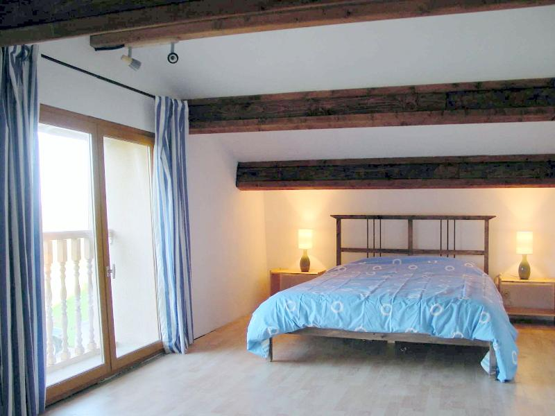 Main bedroom, with french window views across rolling countryside