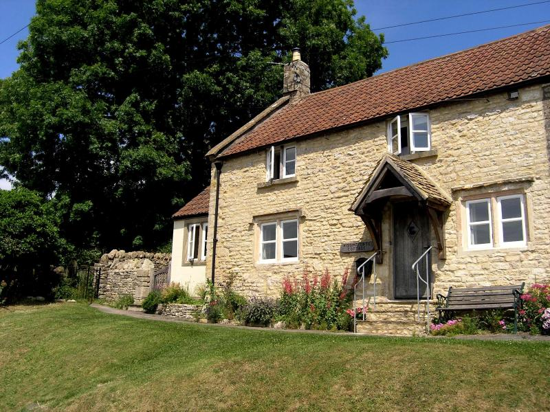 Romantic self catering holiday cottage in Cotswold village overlooking open countryside