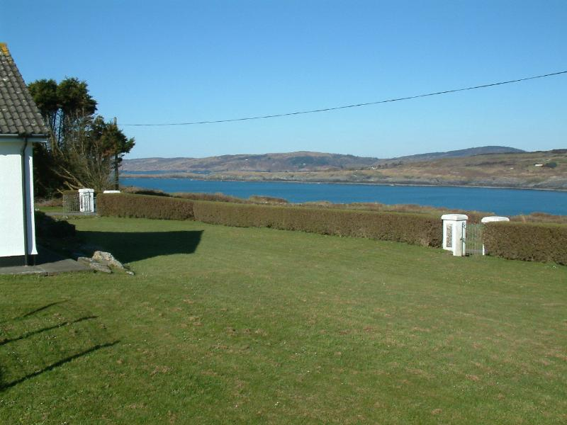 Large garden with views across Toe Head Bay- plenty of space for children to play!.
