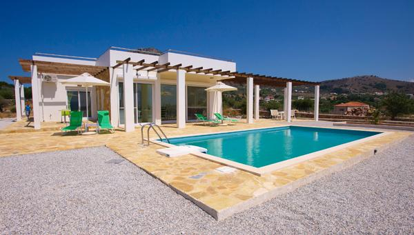 A picture of the front of  villa skye, over to table top moutians in background