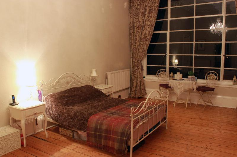 Double bed with views to small garden at the rear (no access).