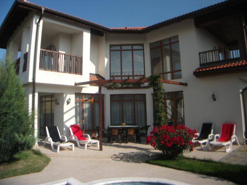 Spacious patio area with shaded pergoda
