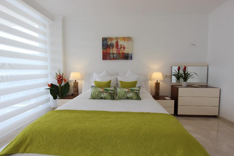 A tropical feel to the second first floor bedroom, you'll certainly get in the holiday spirit h
