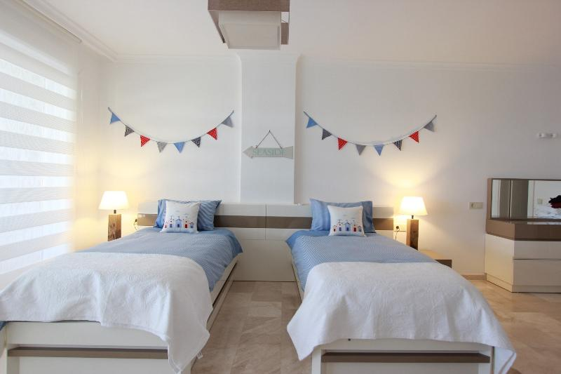 Seaside themed 3rd bedroom has twin beds a sofa bed 42' 3d TV and games console