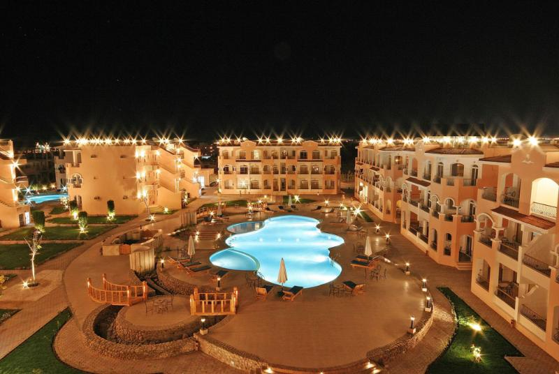 The resort at night with a view over main pool, there are  5 pools in total, all different shapes!