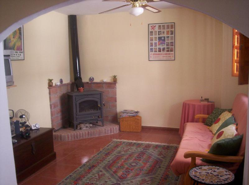 Lounge area with  cosy  woodburner
