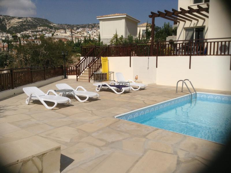 The apartment has direct access to the pool area