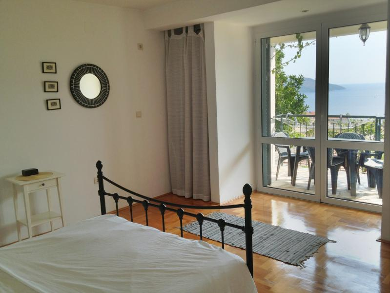 Main Bedroom lower apartment, with double doors  to terrace over looking view south