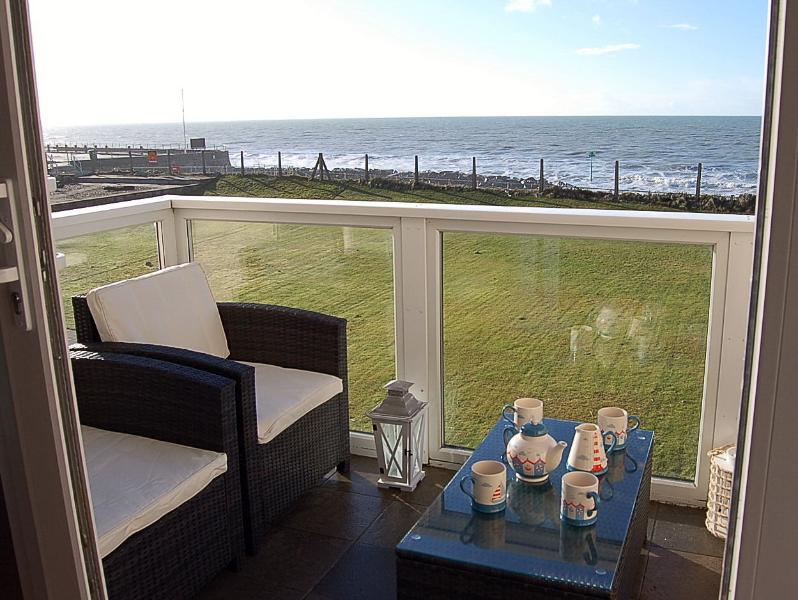 Enjoying stunning sea views. 'Rattan patio furniture'