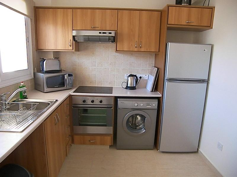 Fully equipped modern stainless steel kitchen