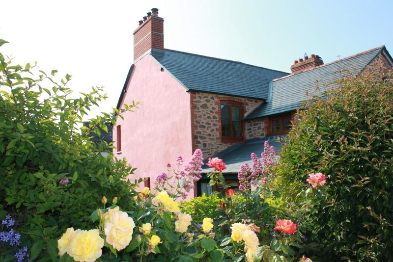 Marley Cottage with its southerly aspect and neat gardens