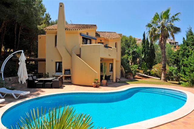 Pool area to villa