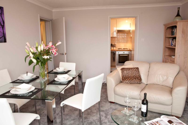 The living room is spacious and comfortable with a balcony overlooking Oxford