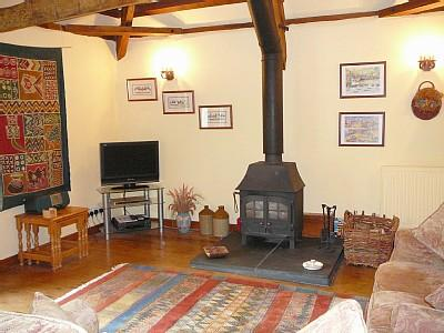 All of the cottages have woodburners, digital TV -- Old Orchard sitting room