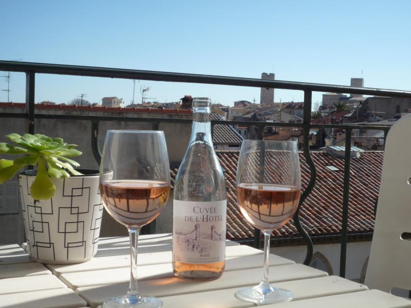 Glass of wine on the balcony.