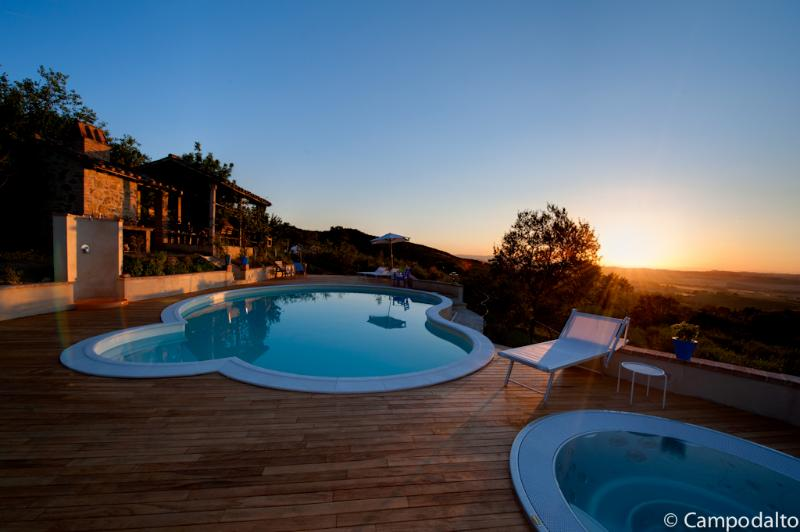 Sunset at the pool & Jacuzzi is ready to relax with a good glass of wine