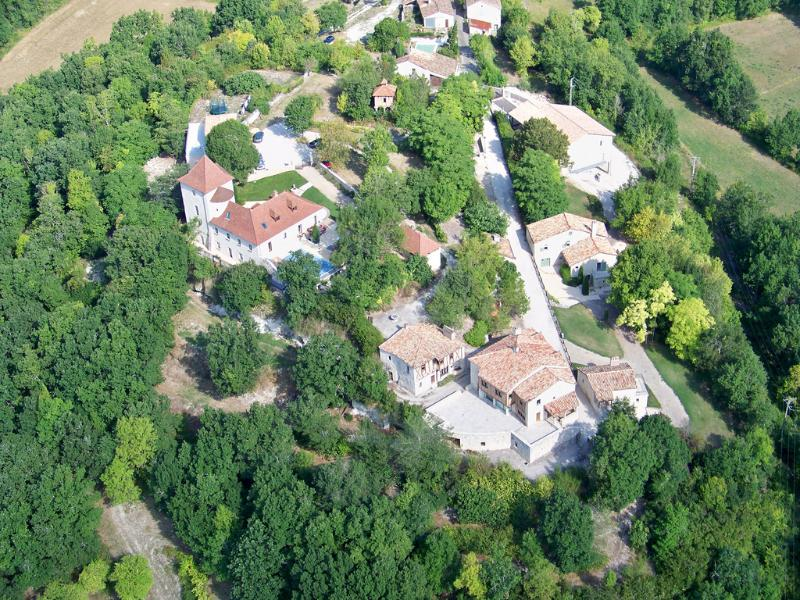 Aerial view of the Bastide surrounded by private woods