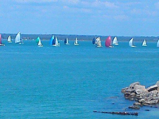 View from front of the bungalow. Watch the colourful small boats sailing past and  the larger ships.