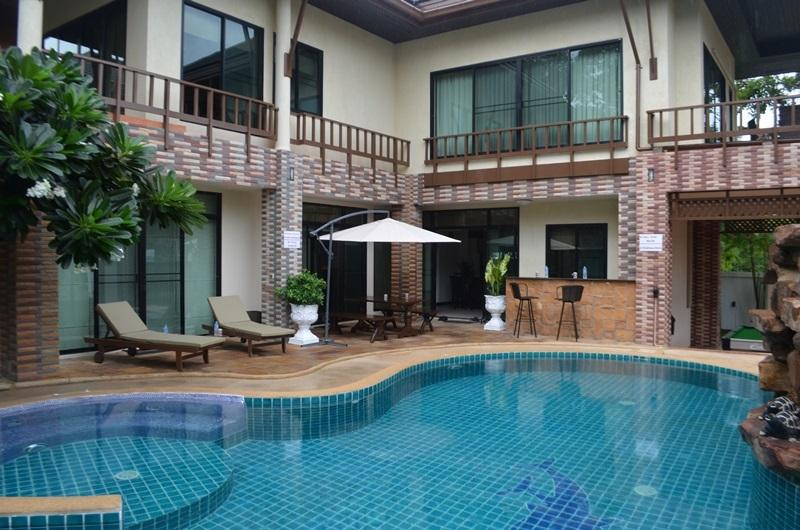Pool area, sun terrace, outdoor covered dining and bar area with main house behind