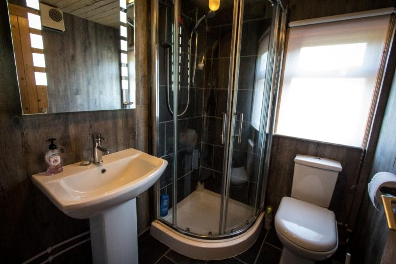 Bathroom with WC, Electric Shower and Sink
