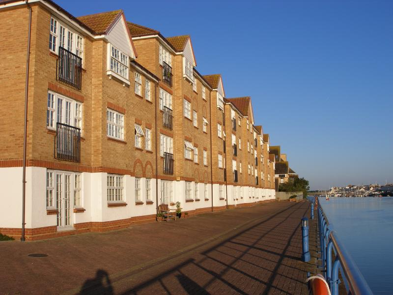 Riverside view of apartment block