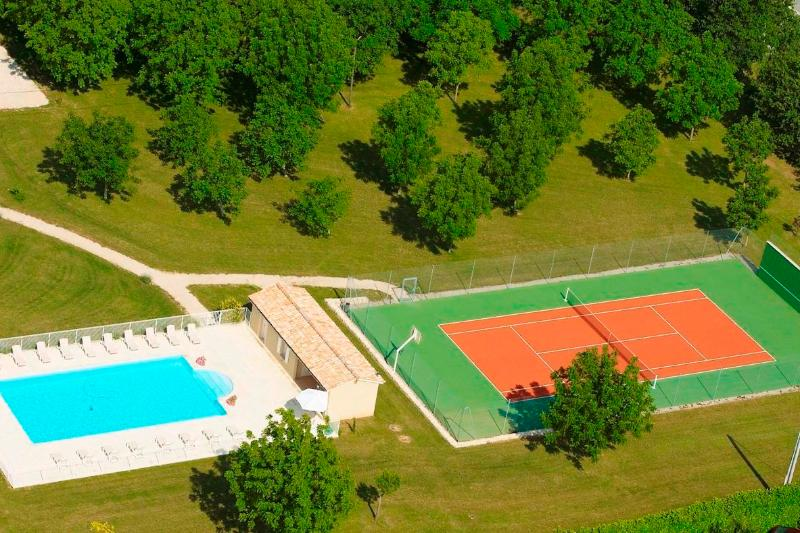 The pool and tennis court
