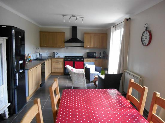 Large, modern well equipped kitchen with views of the village and mountains