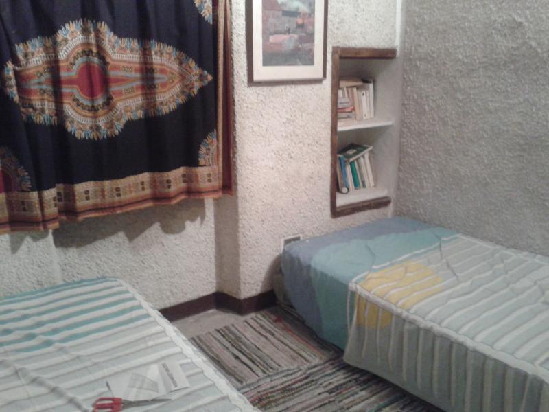 camera con due singoli possibili da unire