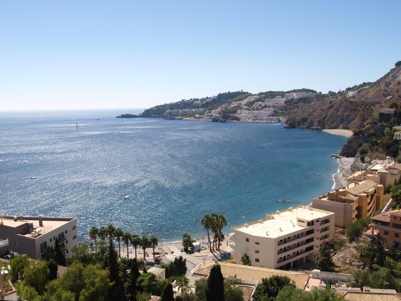 View across Cotobro bay, the beach and to the Marina del Este