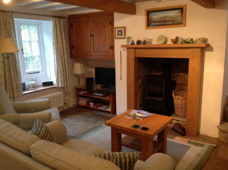 The lounge with Laura Ashley suite and oak furniture
