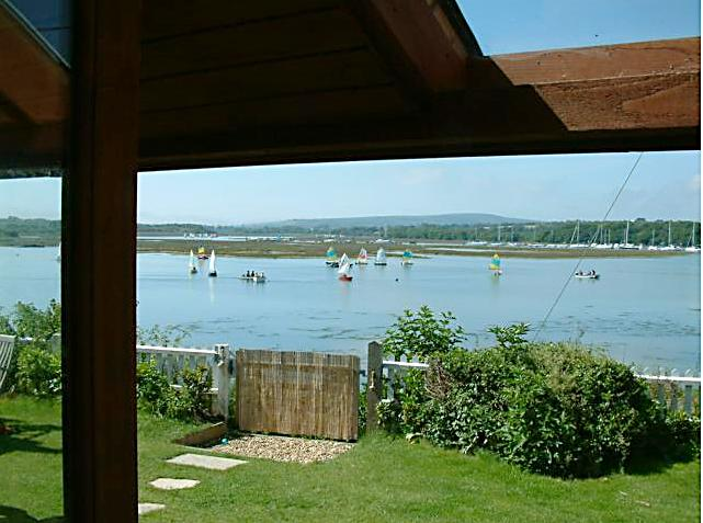 View from the Boathouse overlooking the water and Scows sailing