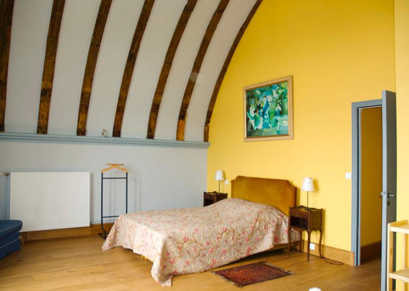 Yellow bedroom with double bed