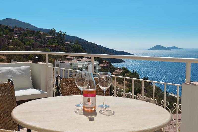 Outside seating area and sun terrace with superb views of the Mediterranean sea and Kalkan harbour.