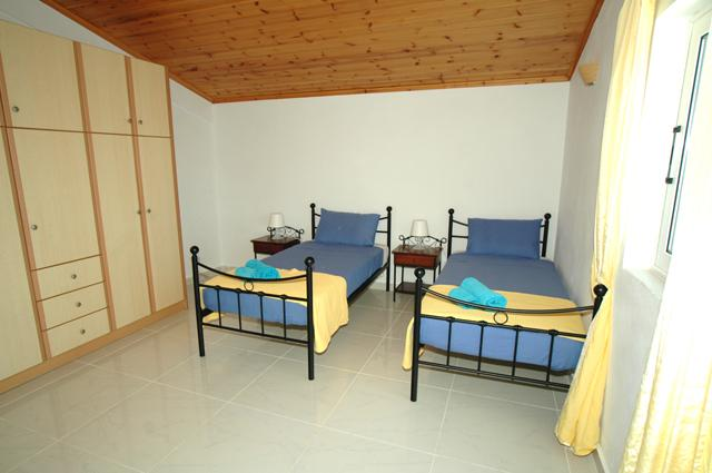 One of the twin bedrooms upstairs. Each one has air conditioning.