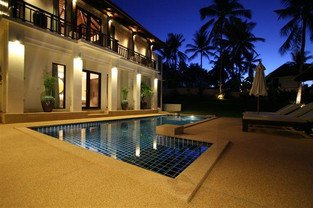 Main building and private pool at dusk