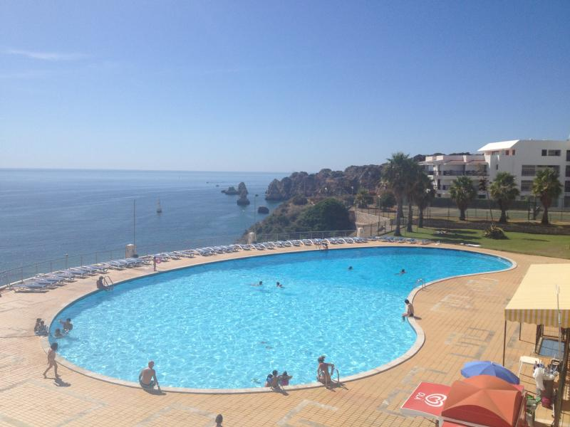 The huge pool and separate children's pool overlooking the sea (not the view from balcony)