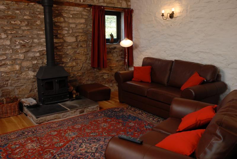 Stone walls, exposed beams and log fire!