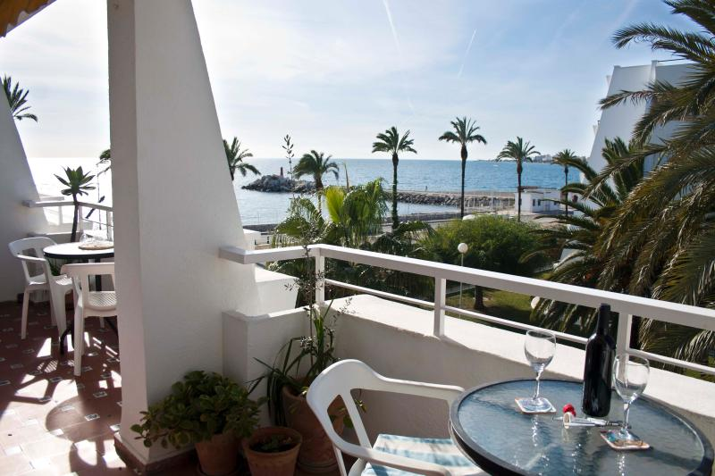 Large Terrace with wonderful views to Caleta Seafront and beyond - access via lounge and kitchen