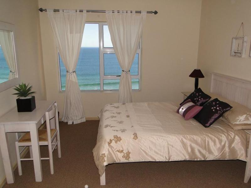 Main bedroom with sea view and en suite bathroom