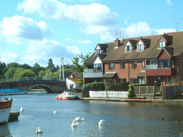Anchor & Riverside Cottages viewed from across the River Bure